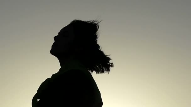 Young Woman Turns Her Head Like a Top Model at a Splendid Sunset in Slo-Mo