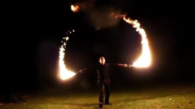 Juggler Blows at His Lit Torches And Causes Huge Flame at Night in Slo-Mo