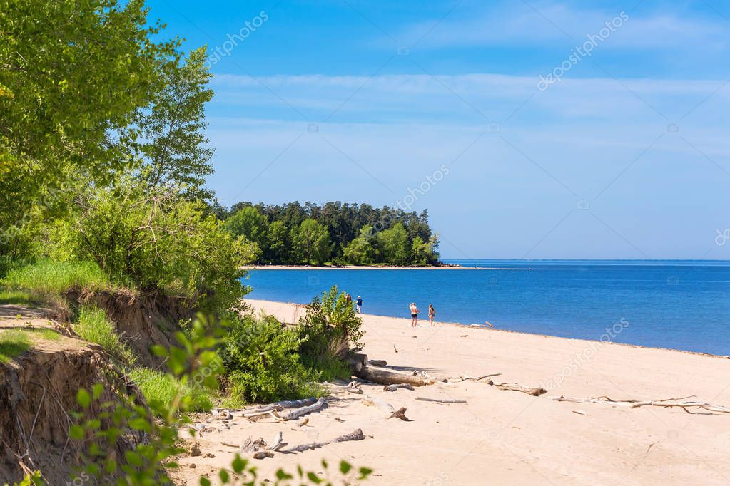The confluence of the Ob and Berd, Berdsk, Novosibirsk oblast, Siberia, Russia - June 4, 2017: the beach with the tourists on the river