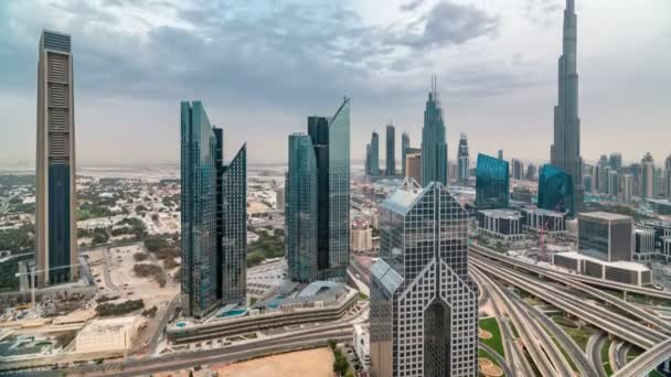 Dubai skyline timelapse at sunset with beautiful city center skyscrapers and Sheikh Zayed road traffic, Dubai, United Arab Emirates