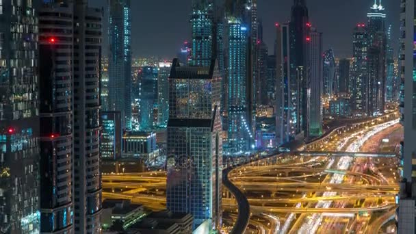 Dubai Downtown timelapse top view at night as shot from a rooftop viewpoint. Dubai, UAE