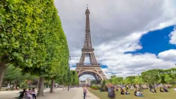 Champ de Mars and the Eiffel Tower timelapse hyperlapse in a sunny summer day. Paris, France