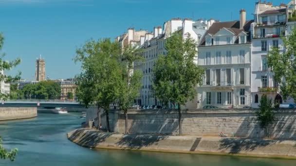 Saint-Louis bridge timelapse with houses on Orleans embankment. Paris, France.