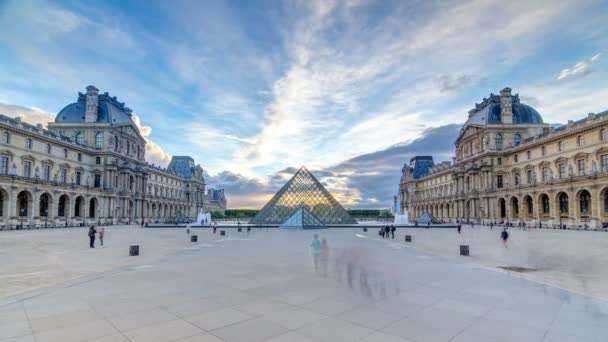 The Louvre museum pyramid at sunset timelapse in Paris, France