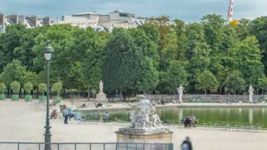 People relaxing in Tuileries Palace open air park near Louvre museum timelapse. Paris, France