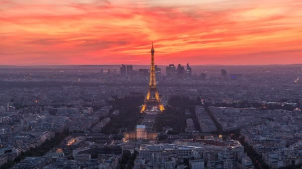 Panorama of Paris after sunset day to night timelapse. Eiffel tower view from montparnasse building in Paris - France