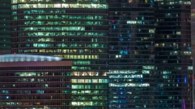 Modern Office Building With Glowing Windows At Night Timelapse  Moscow City Glass A Park Where People Relax