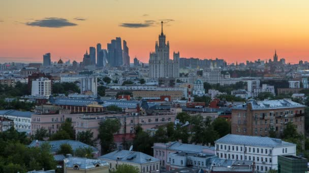 Skyscrapers day to night timelapse, Kremlin towers and churches, stalin houses at evening aerial panorama in Moscow, Russia