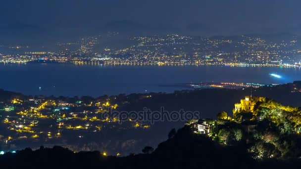 Night timelapse view of the airport in Nice and Mediterranean coastline on the French Riviera