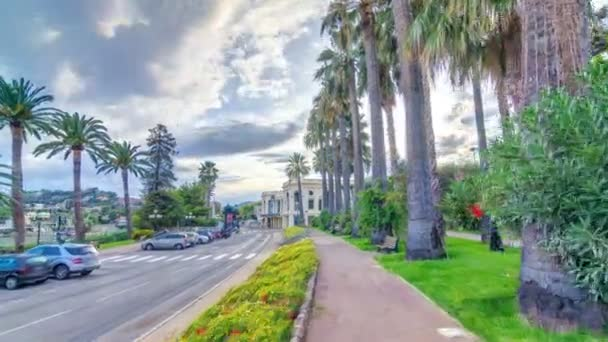 Evening view to palms on the center street of Beaulieu-sur-Mer timelapse hyperlapse.