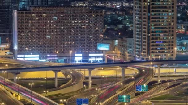 Aerial view of highway interchange in Dubai downtown night timelapse.