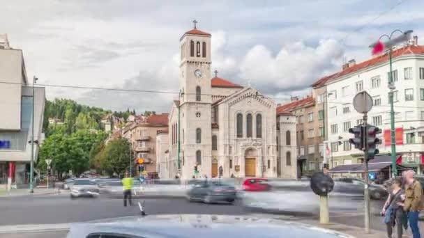 City traffic and people on the cross walk in front of Saint Josephs Church on Titova street timelapse hyperlapse in Sarajevo, Bosnia