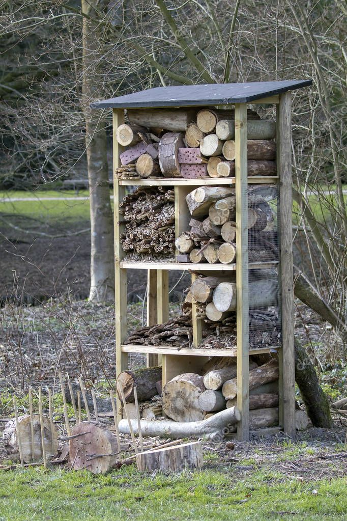 An insect hotel made from dry wood logs