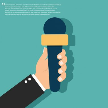 Journalism concept. Microphone in human hand