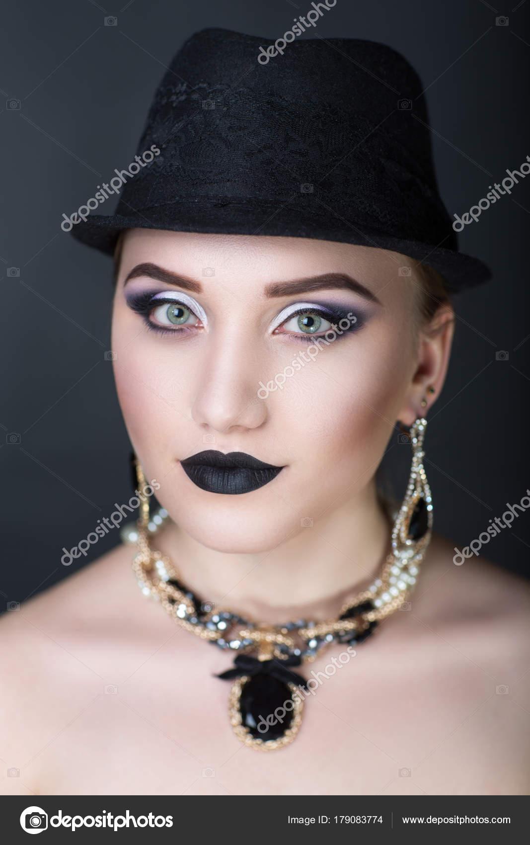 Woman black hat — Stock Photo © OlgaOsa #179083774