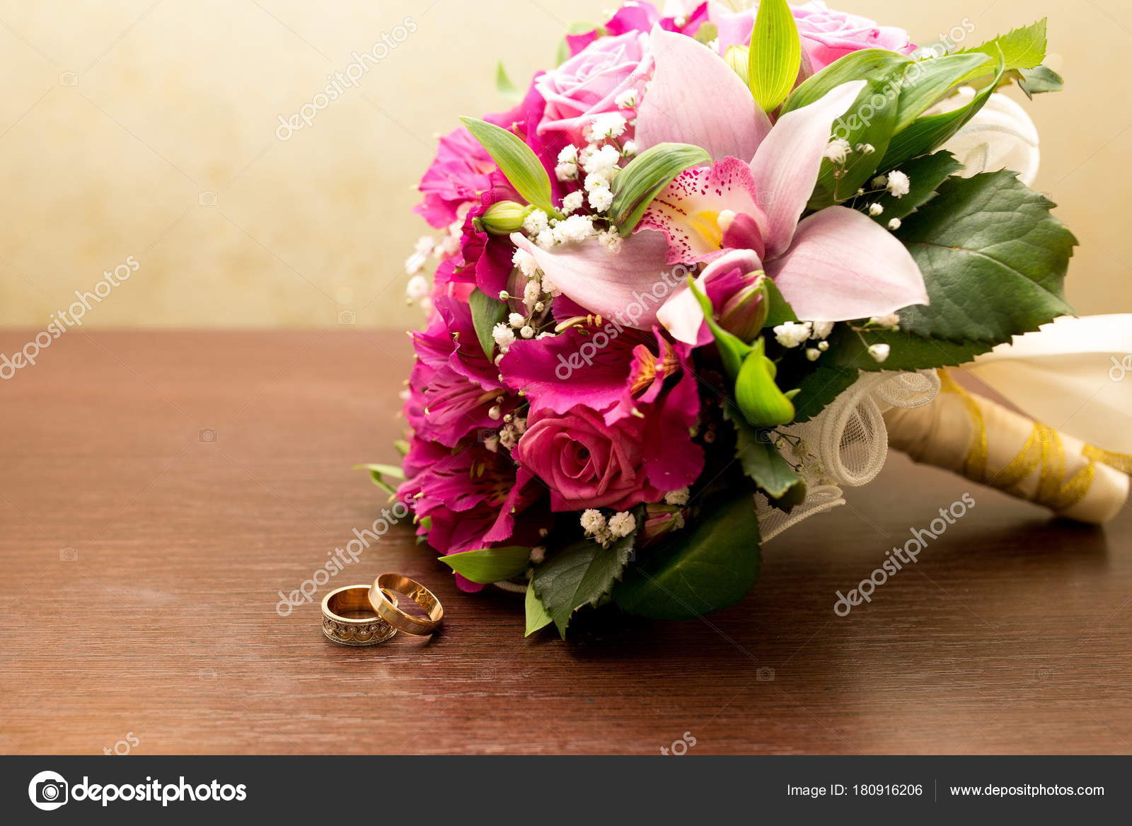 Big flower bouquet stock photo olgaosa 180916206 big bouquet and two wedding rings goods for wedding this photo is perfect for magazines shops dealing with wedding dresses ceremonies bride groom izmirmasajfo
