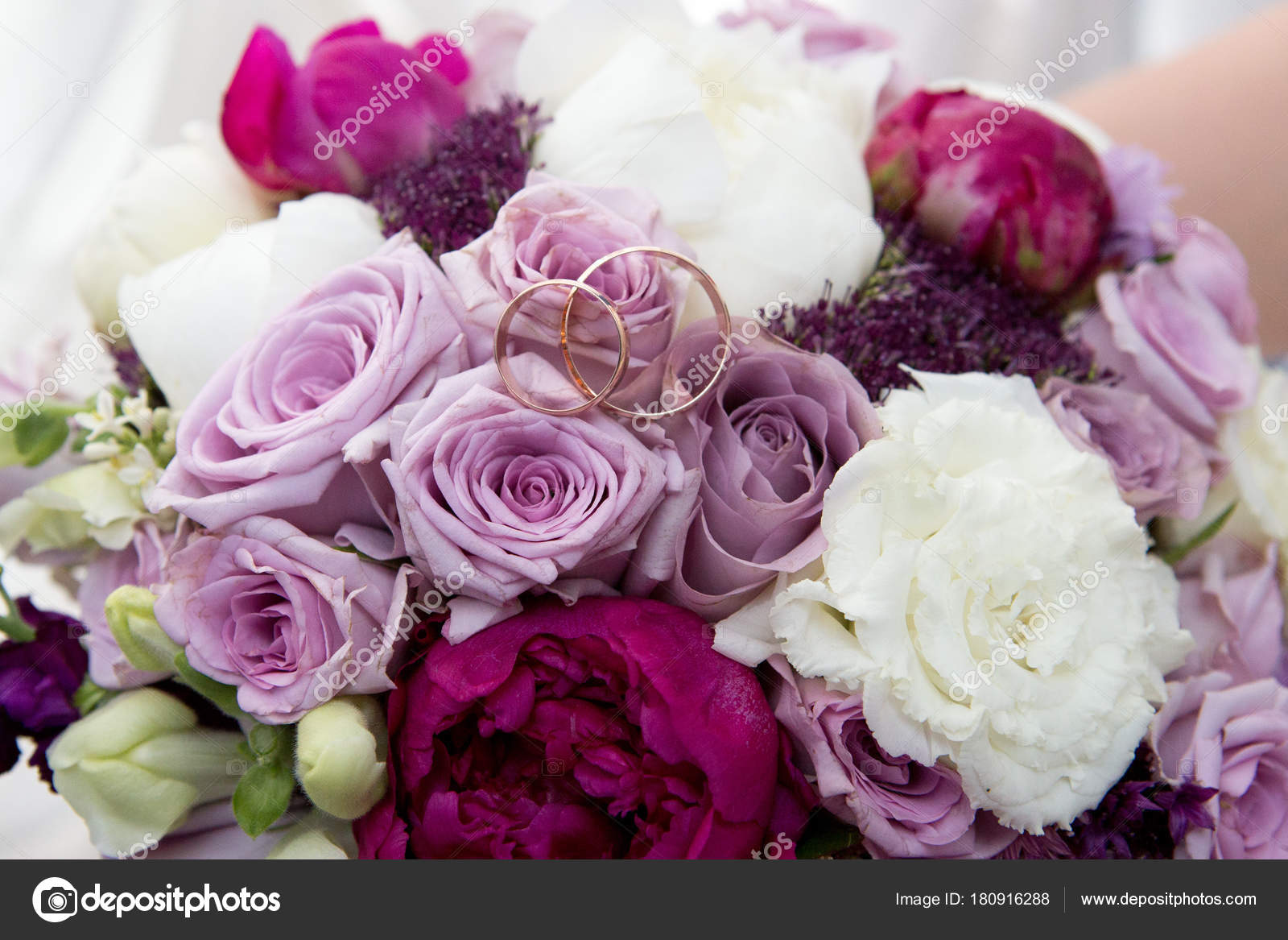 Big flower bouquet stock photo olgaosa 180916288 big bouquet and two wedding rings goods for wedding this photo is perfect for magazines shops dealing with wedding dresses ceremonies bride groom izmirmasajfo