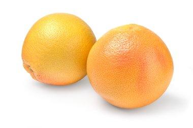 Two ripe grapefruit on white background