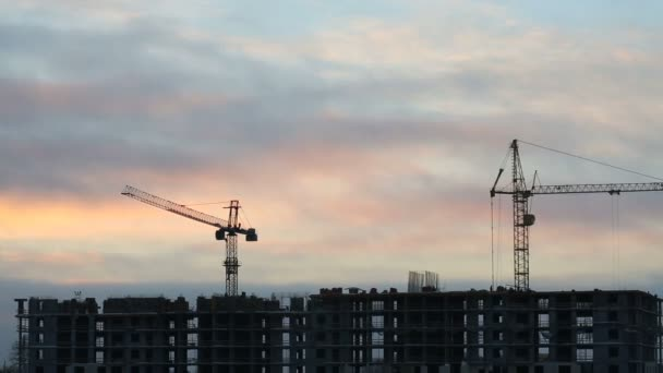 Construction site with working cranes