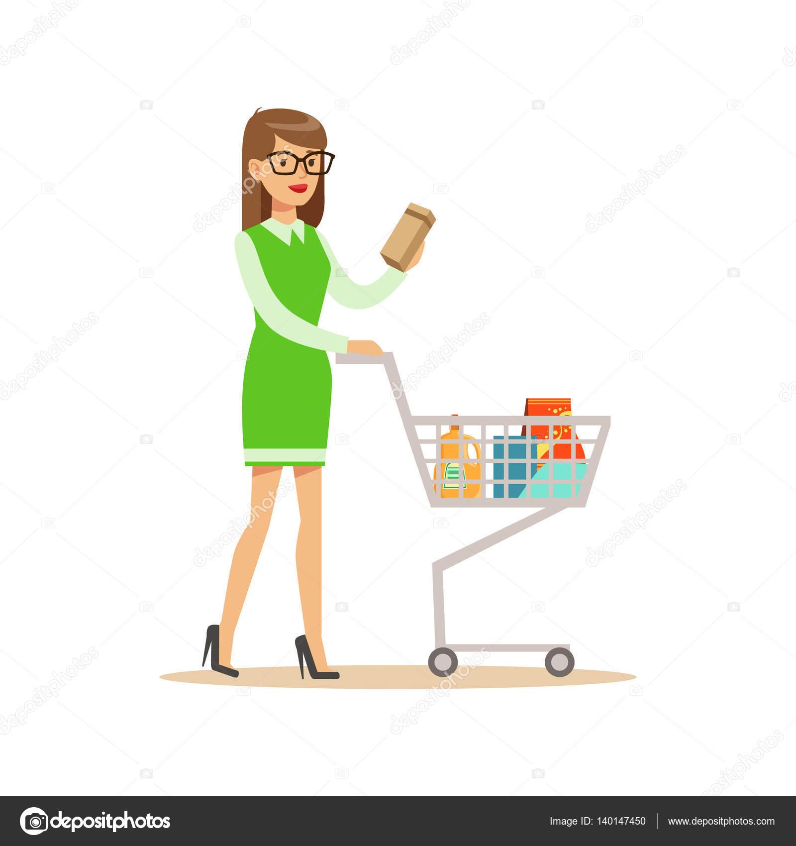 femme en robe verte avec panier shopping en magasin acheter des choses dans la boutique de. Black Bedroom Furniture Sets. Home Design Ideas