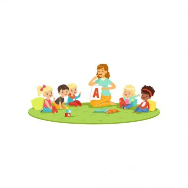 Kids sitting on carpet with teacher and learning to pronounce letter A. Speech therapist teach little boys and girls in playful form