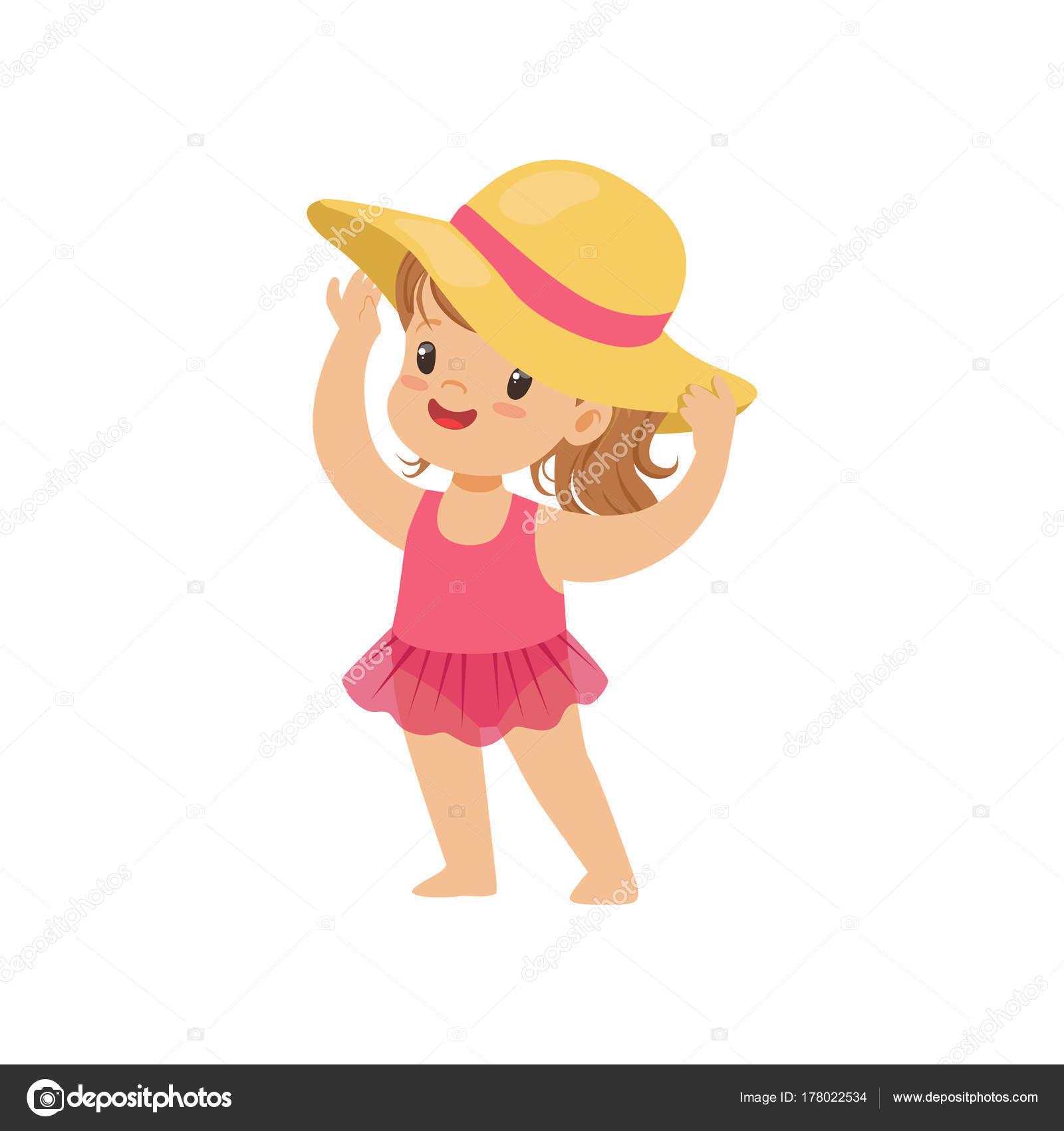 Dulce niña en un traje de baño rosa y un sombrero de paja cd5552f4758