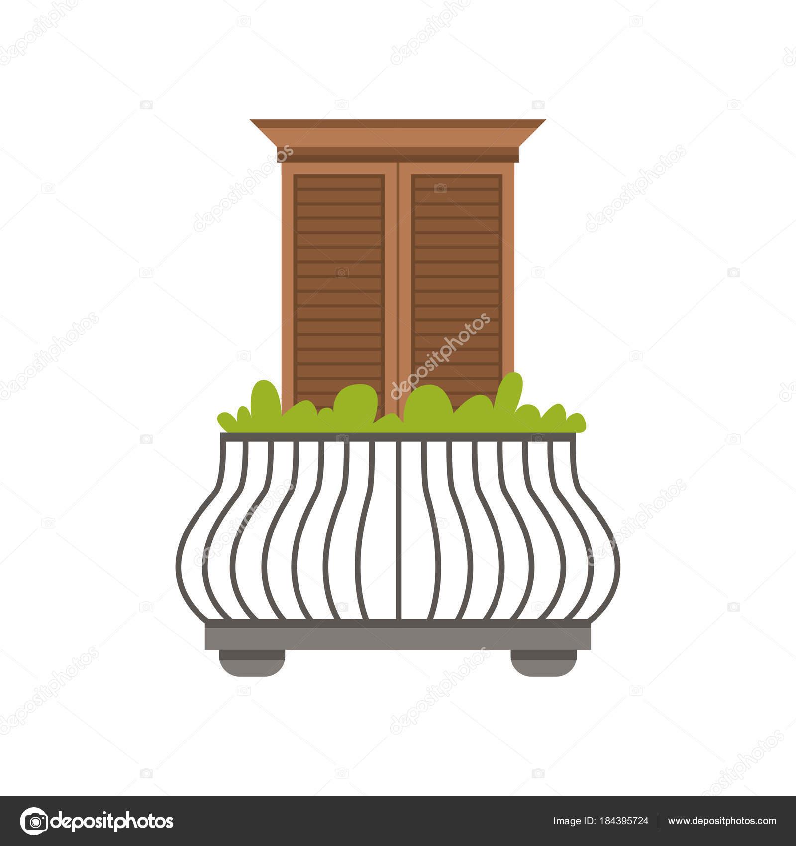 Balcón de la casa europea con barandilla de hierro forjado y plantas ...