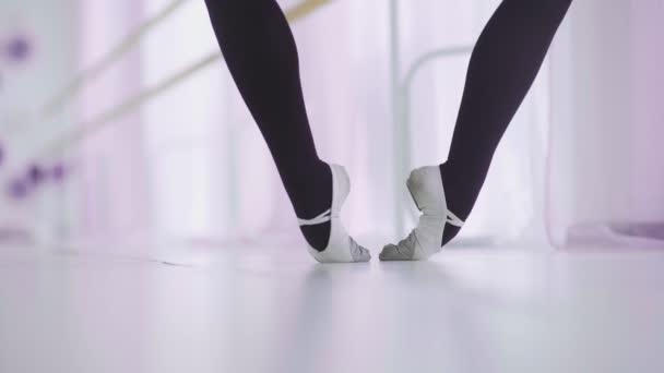 Dance of the ballerina. Female ballet dancer dancing in pointe shoes in studio.