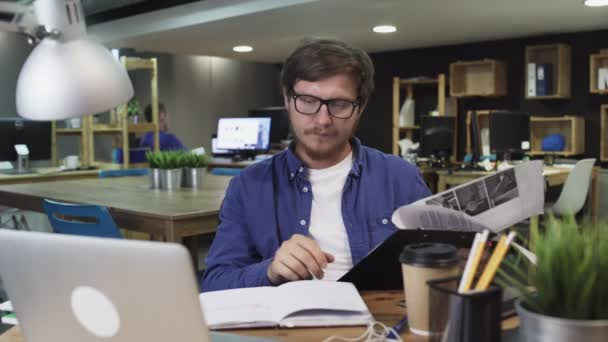 Attractive hard worker working with documents at office