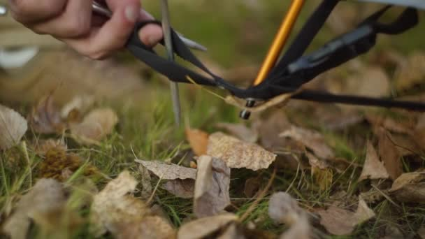 Close up of man setting up outdoor tent