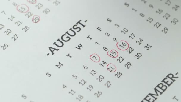 Woman hand mark day on paper calendar. 29st day of the august