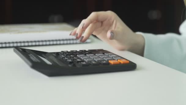 Student is using a large button calculator