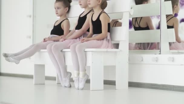Young ballet dancers waiting for the teacher