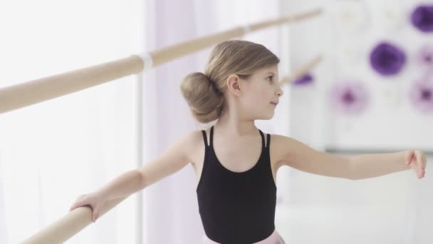 Close up of Little Ballerina In Pointe Practicing Dance At Classical Ballet School