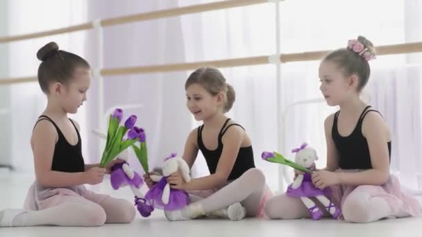 Little ballerinas are playng with toys during break