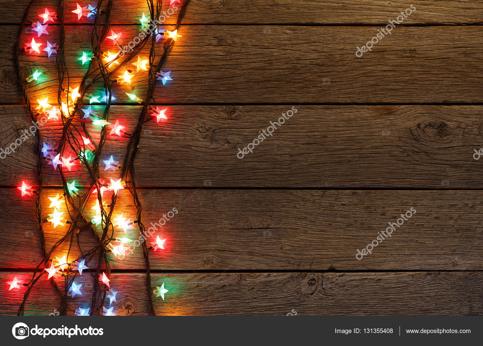 Christmas Lights Background Holiday Shiny Garland Border Top View On Light Brown Wooden Planks Surface Xmas Tree Decorations Winter Holidays Illumination