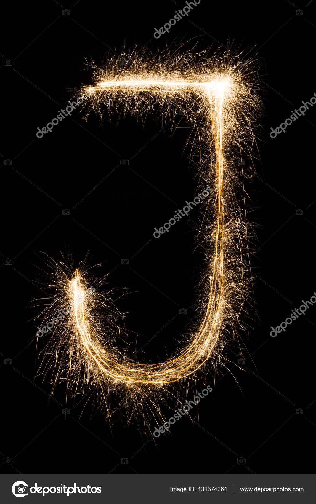 English Letter J from sparklers alphabet on black background