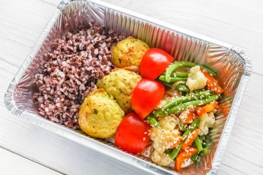 Healthy food in boxes, diet concept. Falafel