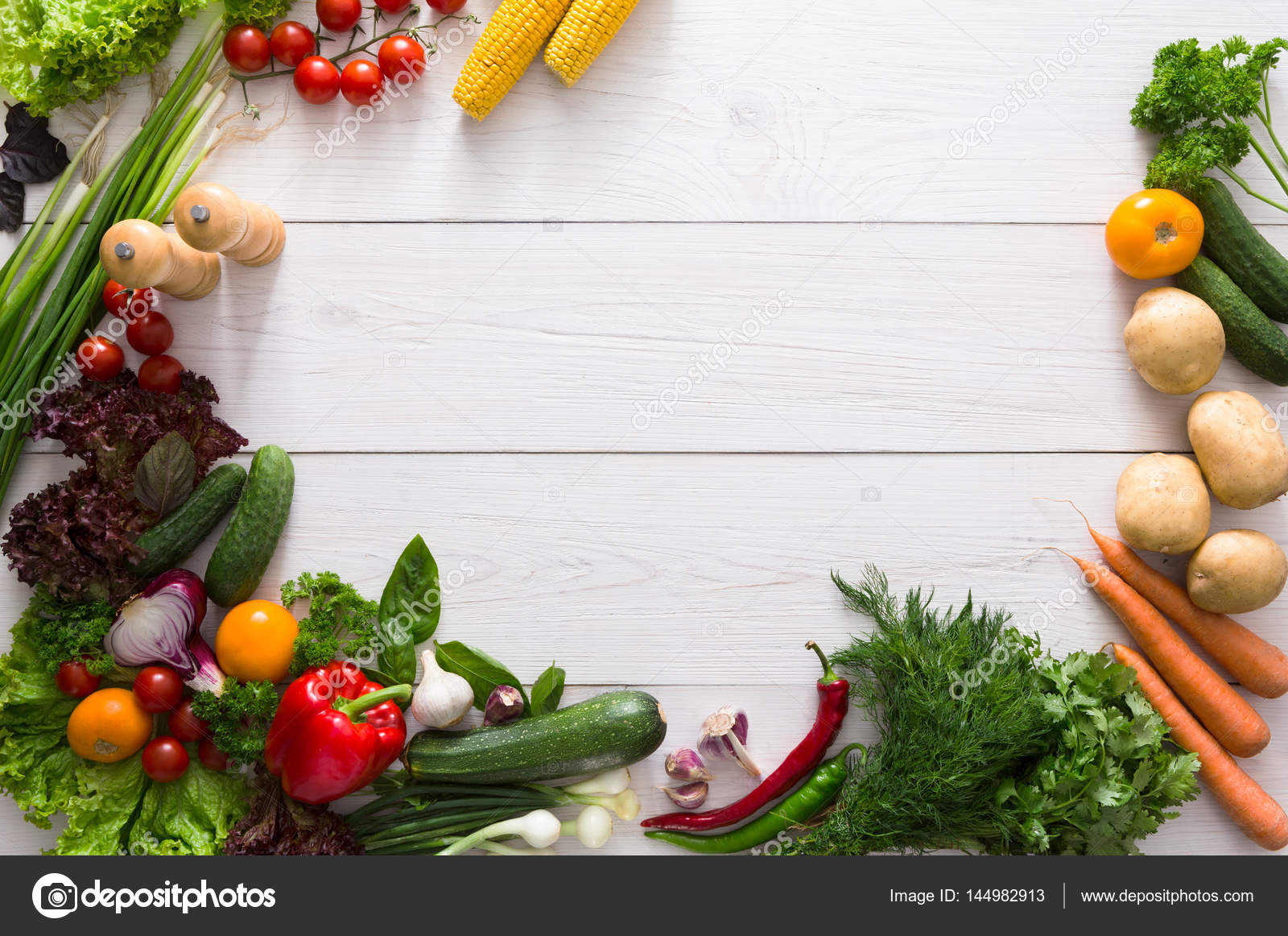 Border of fresh vegetables on white wood background with ...