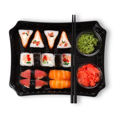 Set of sushi maki and rolls closeup in delivery box isolated at white