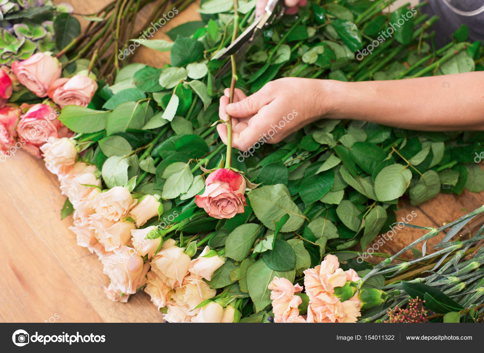 Man Assistant In Flower Shop Delivery Make Rose Bouquet Closeup