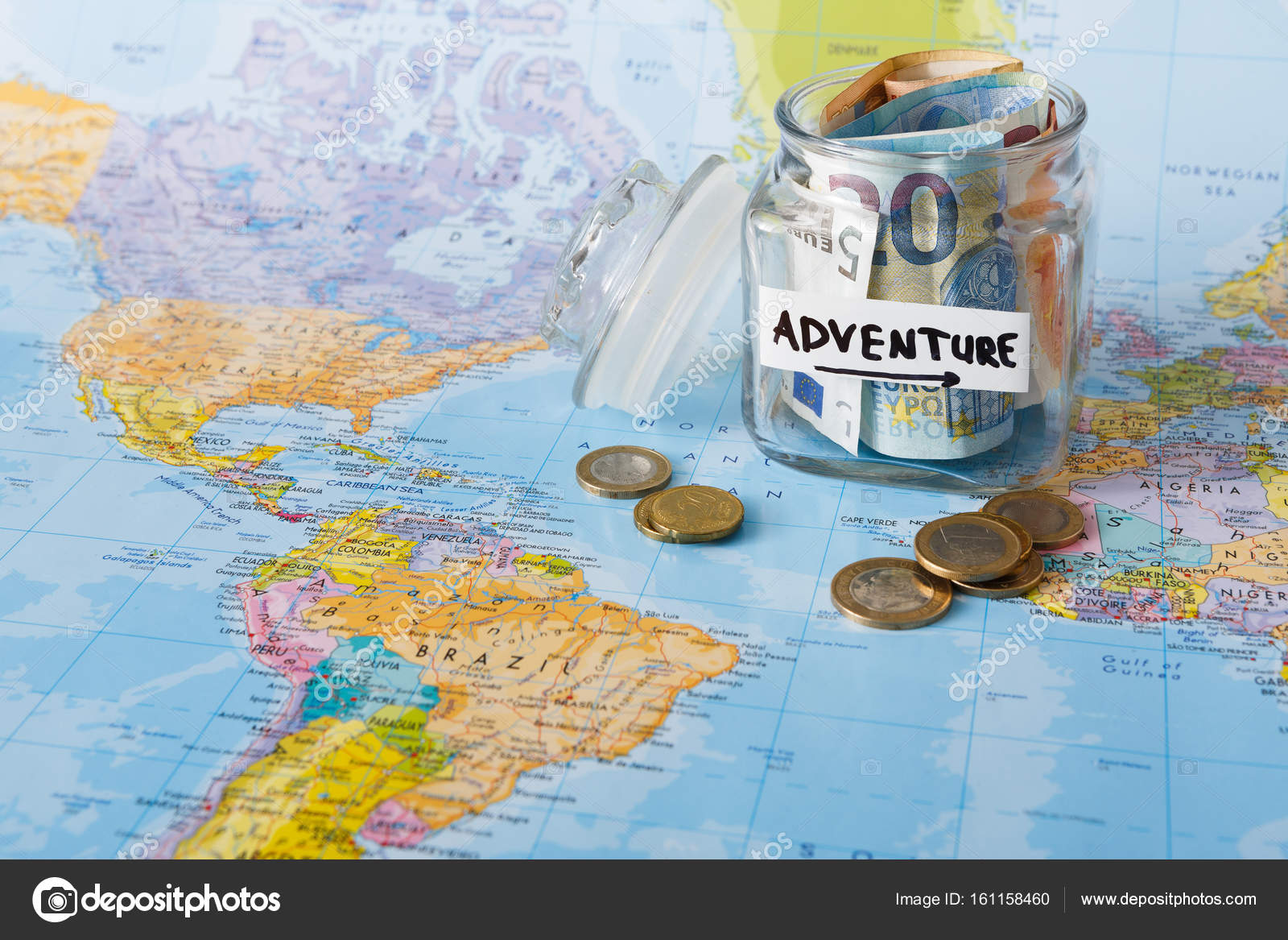 Travel budget concept money saved for vacation in glass jar on map money saved for vacation in glass jar on world map background copy space banknotes and coins for big adventure photo by milkos gumiabroncs Gallery