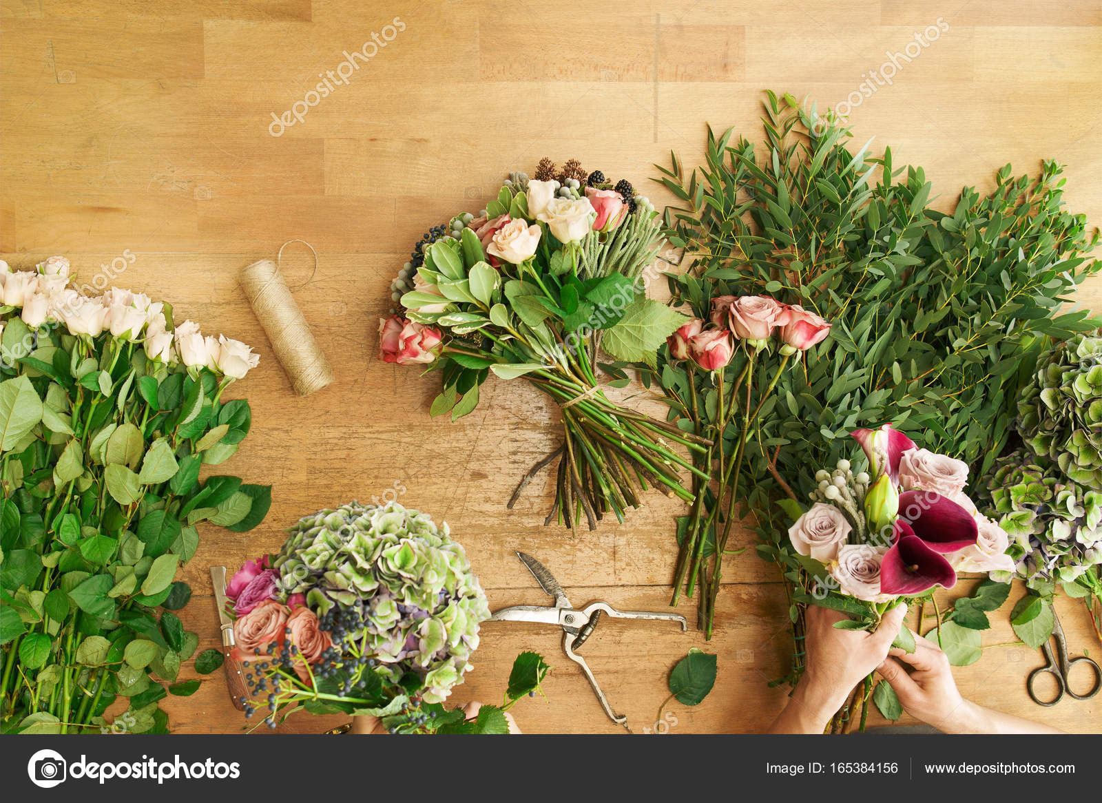 Florist In Flower Shop Delivery Make Rose Bouquet Table Top View
