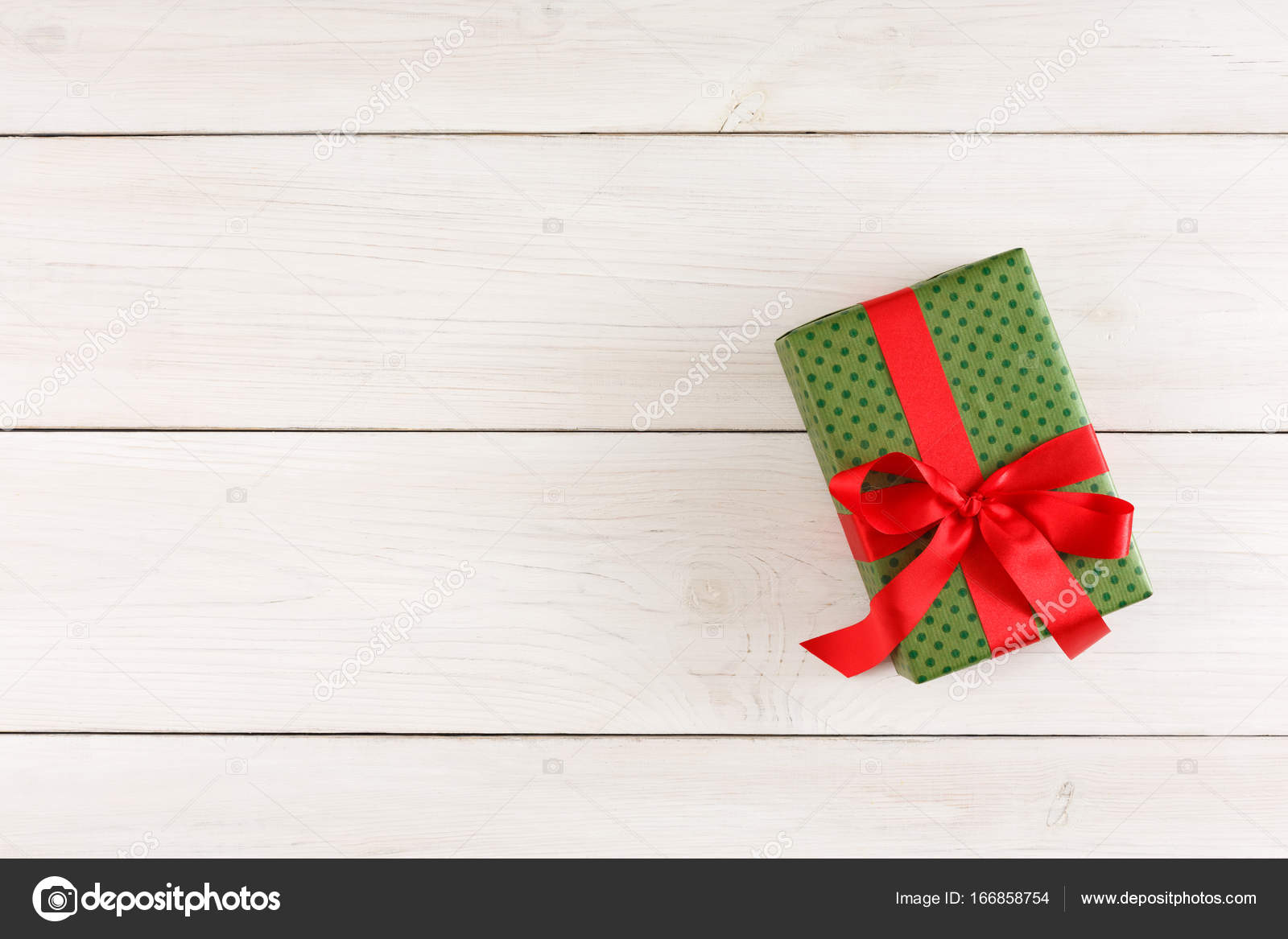 Xmas gift box on white wood table top view with copy space stock xmas gift box on white wood table top view with copy space stock photo negle Choice Image