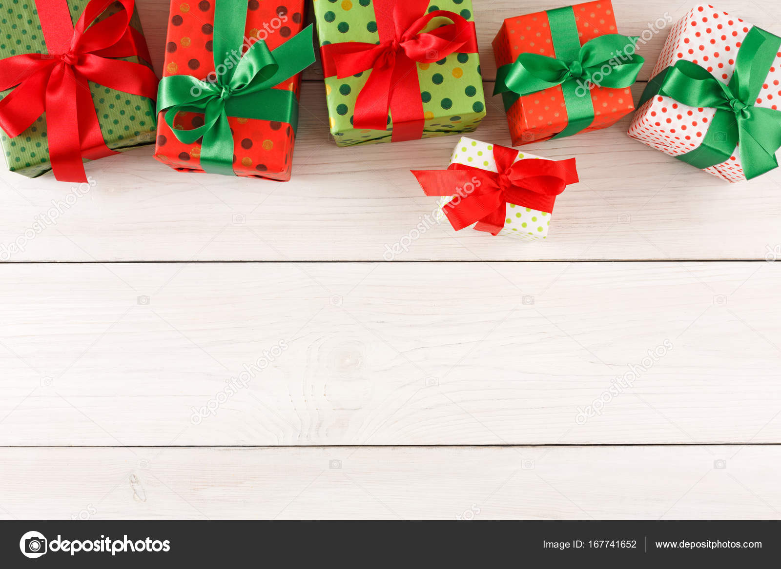 Christmas gift boxes top view on wood table background.u2013 stock image  sc 1 st  Depositphotos & Christmas gift boxes top view on wood table background. u2014 Stock ...