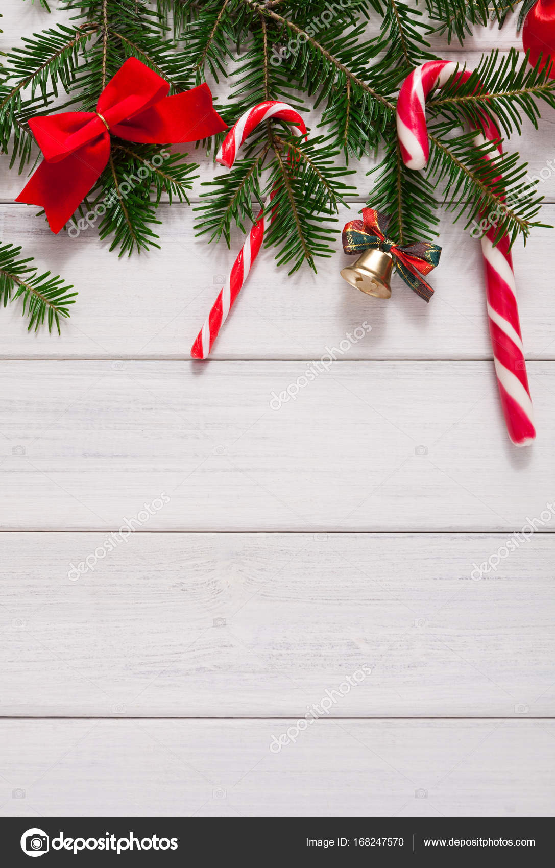 christmas background with candies and fir tree border on wood