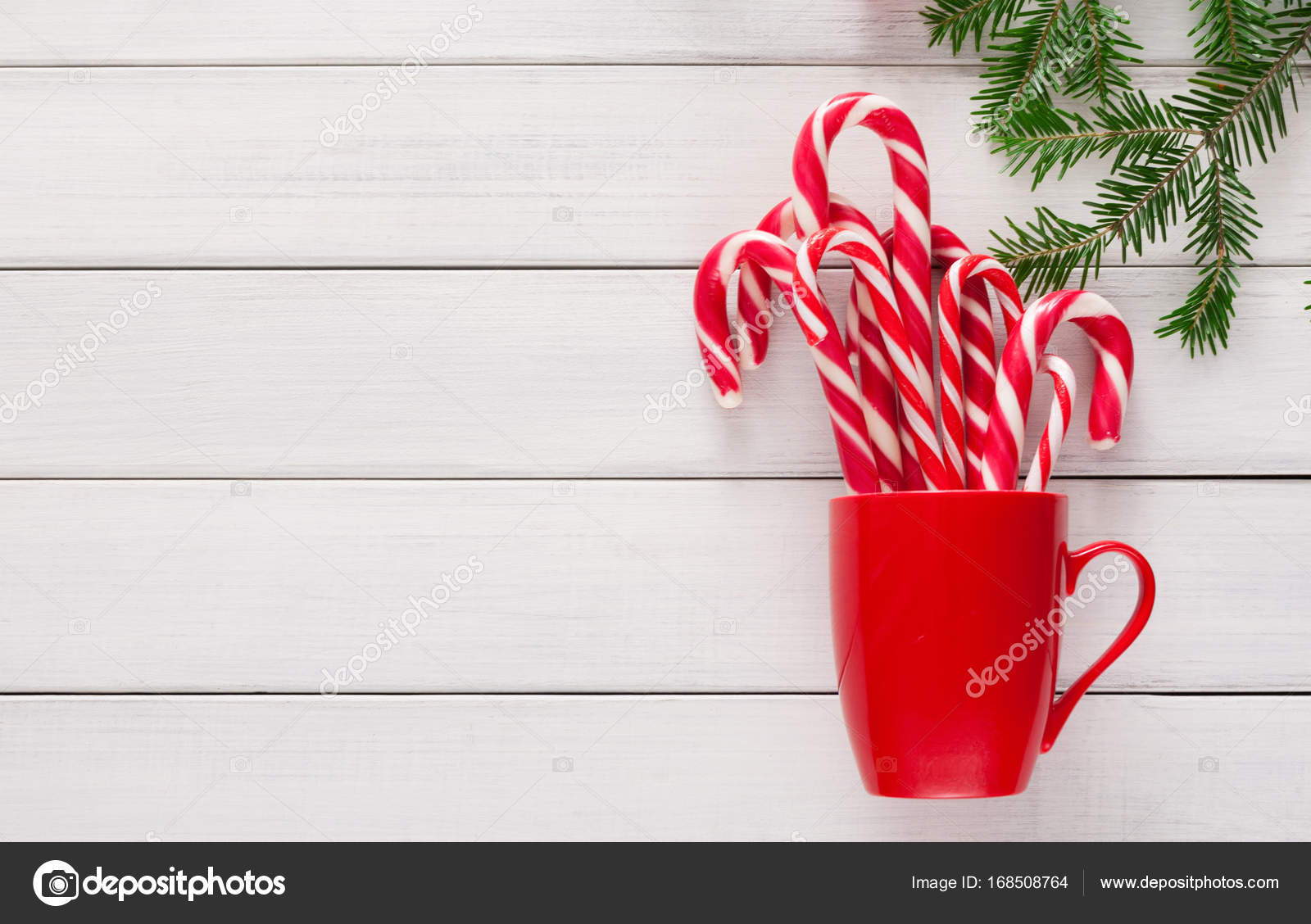 Joyful christmas background with traditional candy cane lollipops ...