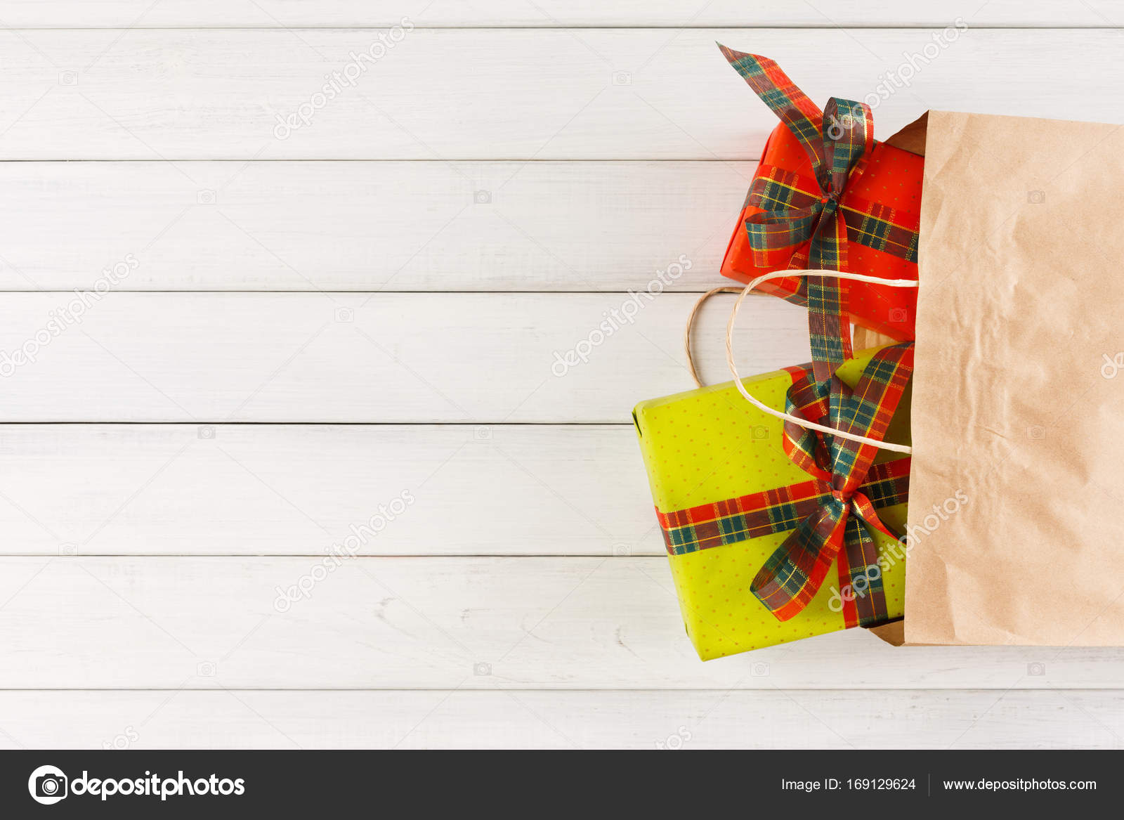 Colored handmade christmas gifts in craft paper bag on white wood table background. Copy space top view u2014 Photo by ...  sc 1 st  Depositphotos & Traditional christmas gifts in paper bag on white rustic wood table ...