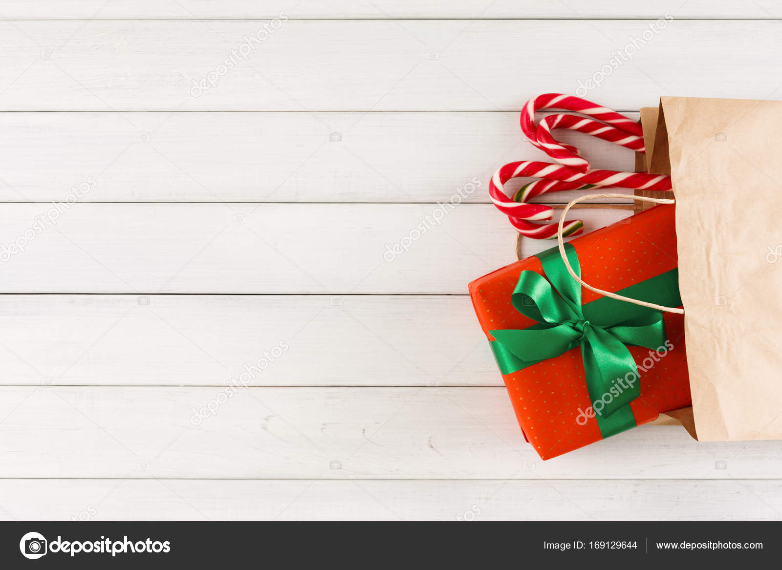 Traditional christmas gifts in paper bag on white rustic wood table ...