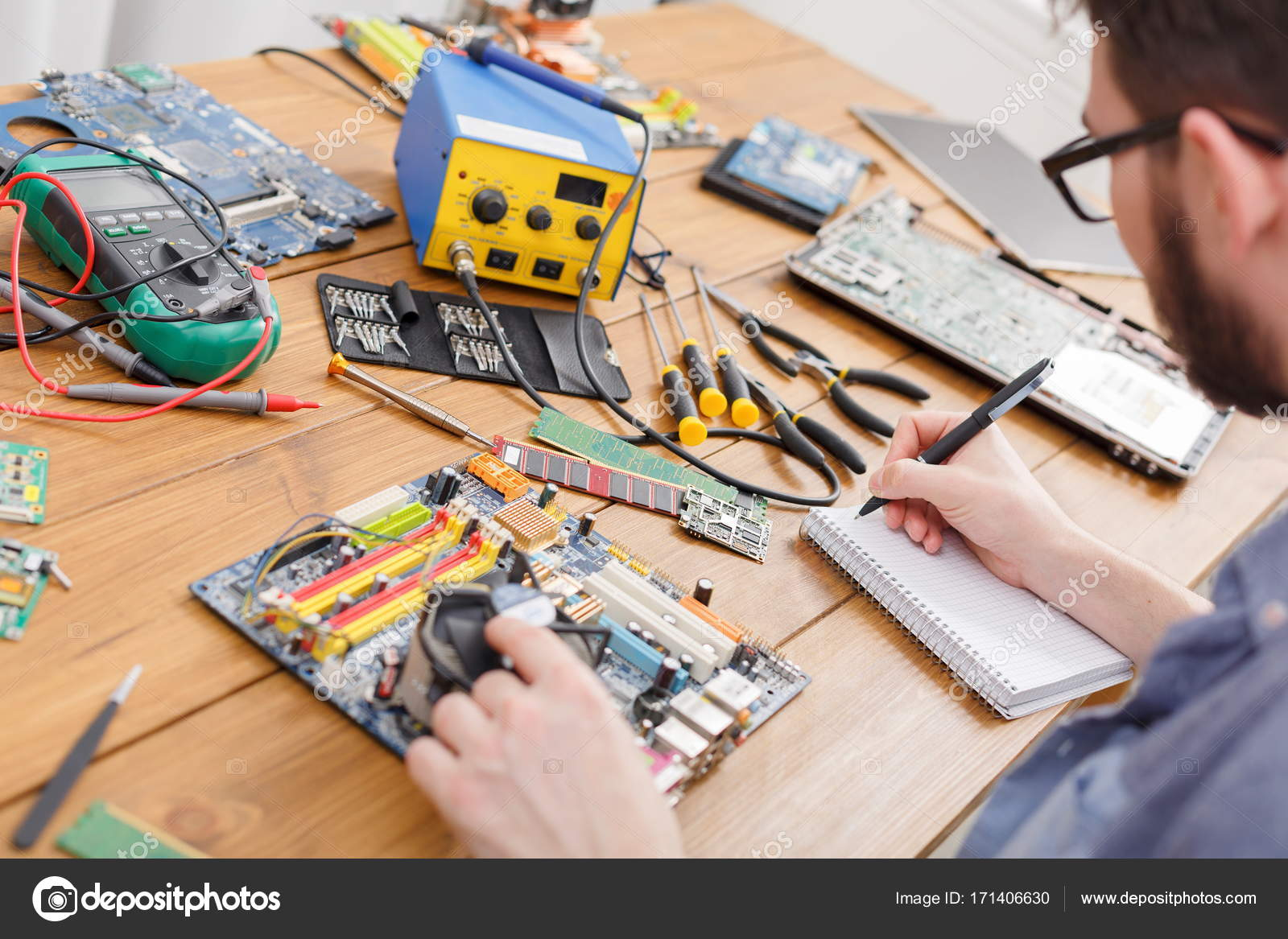Electronic Circuit Board Inspecting In Repair Shop Stock Photo